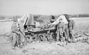 L/Cpl Phillips, Pte Best, Pte Watson and Cpl Walter of 6th Airborne Division investigate the remains of a German self-propelled gun which they knocked-out, 5 August 1944.