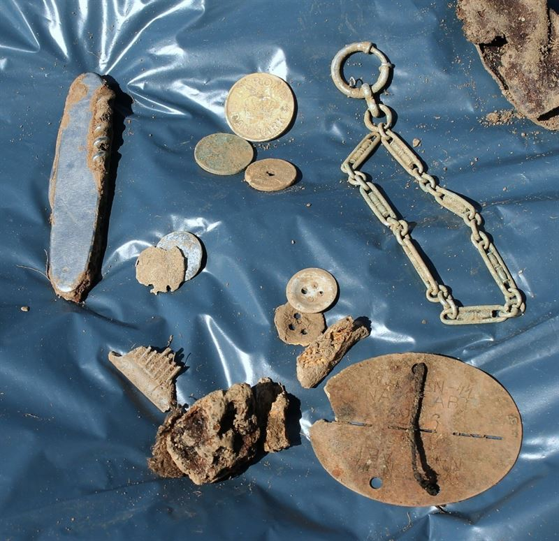 Personal belongings that were recovered with the remains of the missing German soldier.