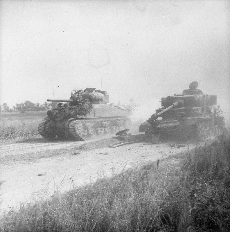 A Sherman tank passes a wrecked German Mk IV near Cagny during Operation 'Goodwood', 18 July 1944.