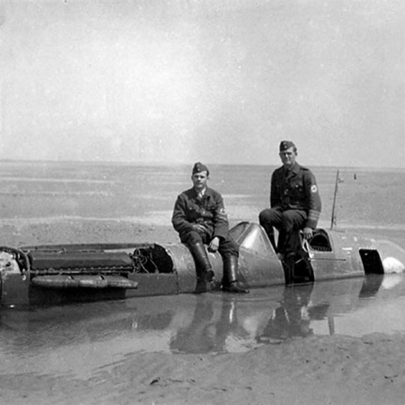 German soldiers posing with the wreckage of Spitfire P9374