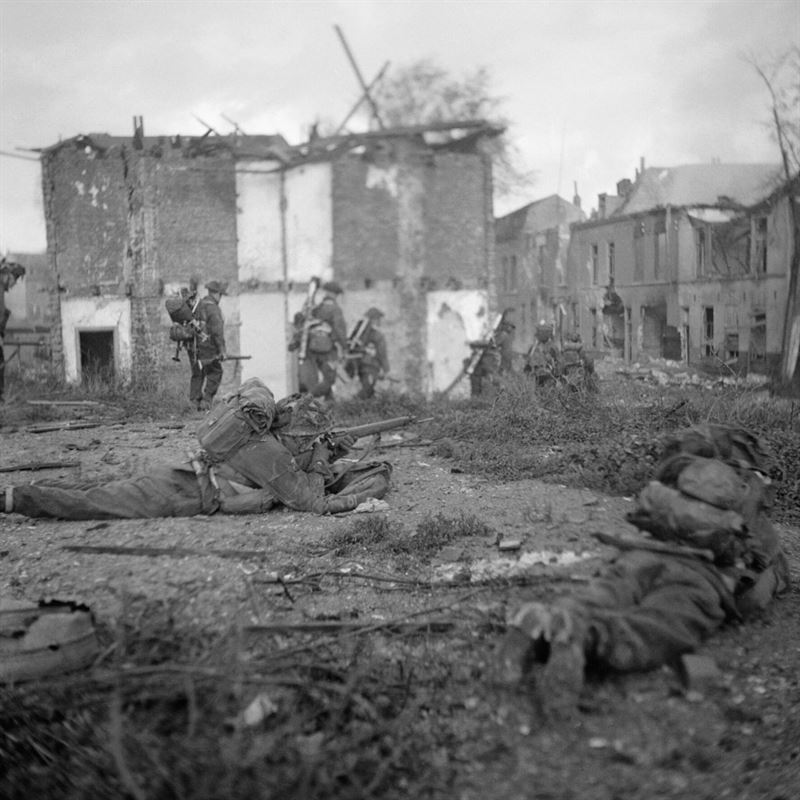 These images show the British assault troops advancing through the streets at Flushing where there was sharp fighting.