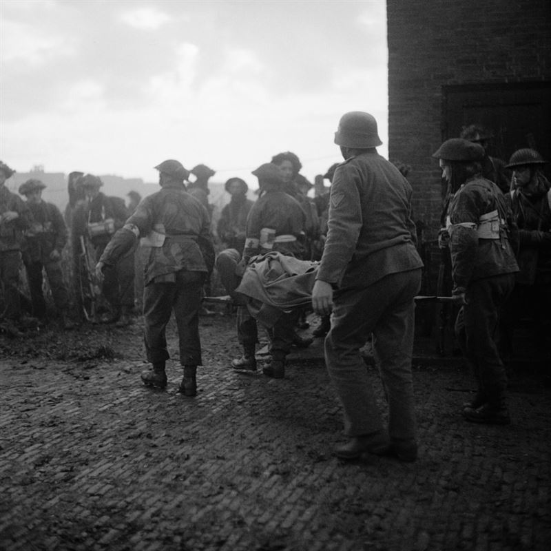 This image shows the wounded being attended to by a British medical officer.