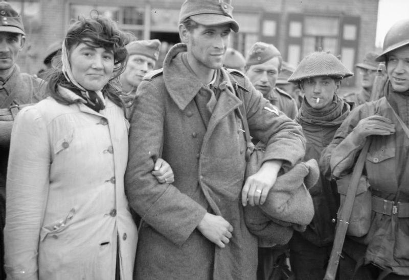 Among the prisoners taken on Walcheren was this Dutch woman. She is seen here in this R.A.F photograph with her husband, a German solder, whom she refused to leave. She marched with the German prisoners to the Prisoner of War cages.