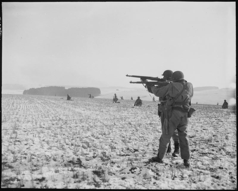 Infantrymen fire at German troops in the advance to relieve the surrounded paratroopers in Bastogne.