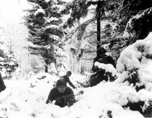 American infantrymen of the 290th Regiment fight in fresh snowfall near Amonines, Belgium
