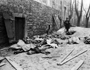 The bodies of Belgian men, women, and children, killed by the German military during their counter-offensive into Luxembourg and Belgium, await identification before burial