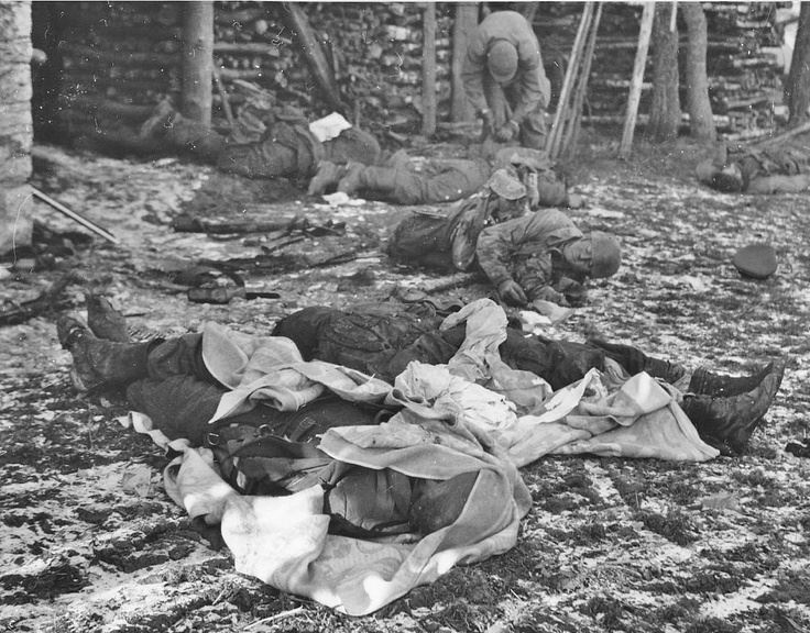 "Grenadiers of the 12.SS Panzer Division ""Hitlerjugend"", killed in battle with the US 509th Parachute Regiment during the offensive in the Ardennes, Dec 1944. Note the body center background frozen in place with head off the ground."