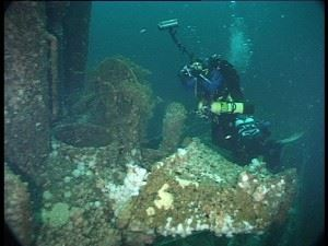Innes's Wife Patricia photographing the open conning tower hatch of U-155