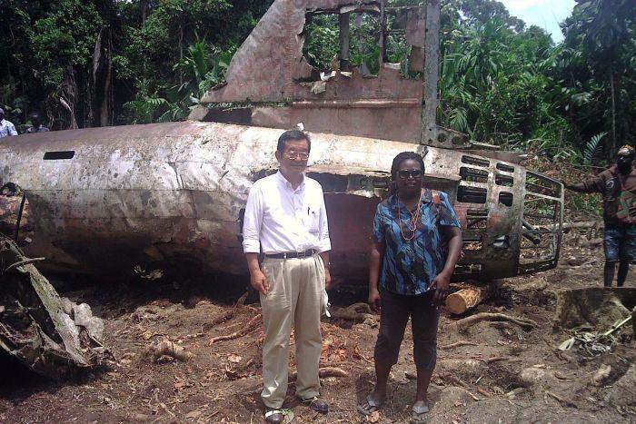 Japanese ambassador to PNG Hiroharu Iwasaki at the Yamamoto crash site. (Credit: New Dawn FM)