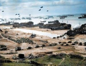 Landing ships putting cargo ashore on Omaha Beach, at low tide during the first days of the operation, June 1944.