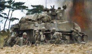 M4 Sherman (US Army 3099276) of 'A' Company 763rd Tank Battalion and troops from the 96th Infantry Division in battle at Okinawa, April 1945.