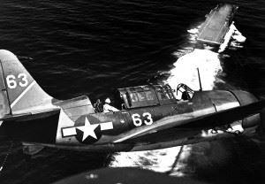 Aerial view of SB2C in upper landing circle showing USS YORKTOWN, below. July 1944. (Navy)