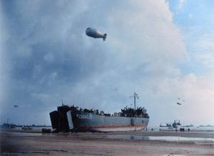 A Landing Ship unloads at low tide on Normandy Beach six days after D-Day. June 12, 1944.