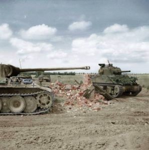 A Sherman tank of 24th Lancers, 8th Armoured Brigade, passing a knocked-out German PzKpfw V Panther #204 of 2.Kompanie/SS-Panzer-Regiment 12, 12th SS-HJ near Rauray, Normandy.(Colorized byGabriel Bîrsanu)