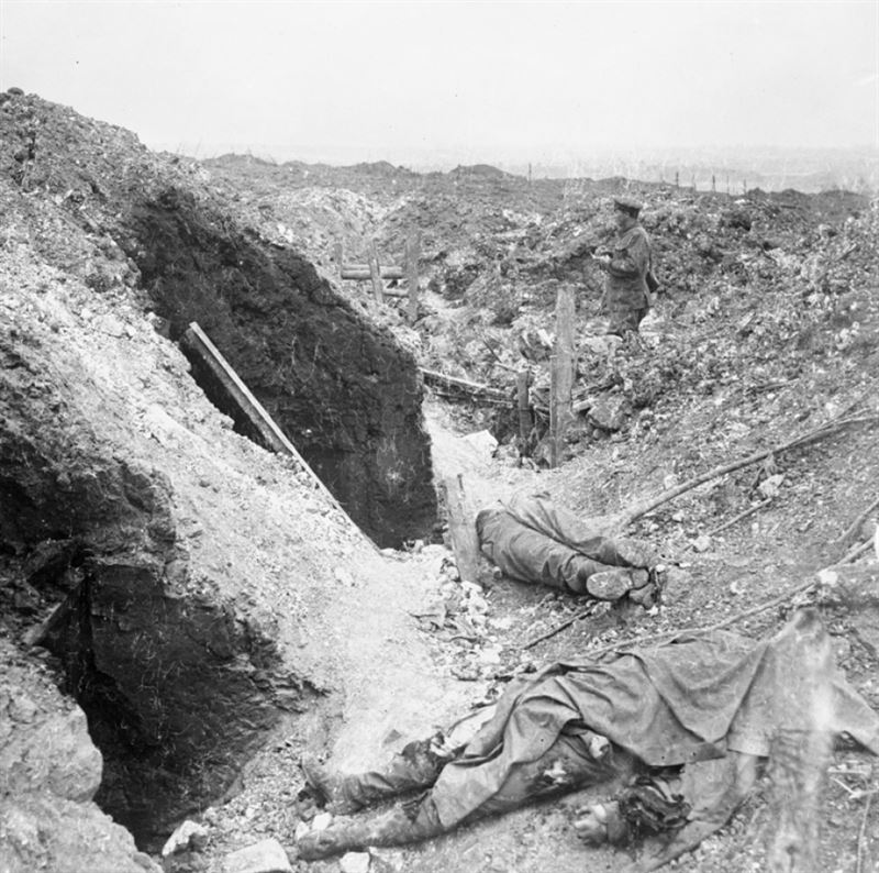 The bodies of two German soldiers lie in a trench badly damaged by artillery fire, July 1916. (Credit: Imperial War Museum)