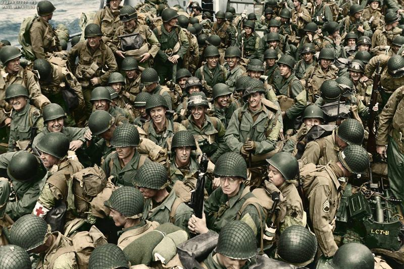 Members of the 101st Airborne Infantry Division and the 4th Infantry Division crowd aboard an LCT on the way to Utah Beach, June 6, 1944.