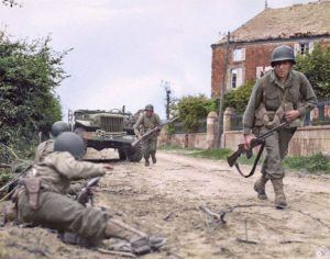 G.I.'s from (possibly) the 1st Btn, 314th Inf. Rgt. of the US 79th Inf. Div., during an attack on the Bolleville road, just north west of La Haye-du-Puits in Normandy.