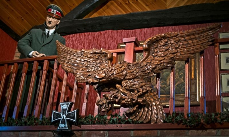 A wax figure of Hitler surveys the dining room in Kevin Wheatcroft's house. (Credits: David Sillitoe for the Guardian)