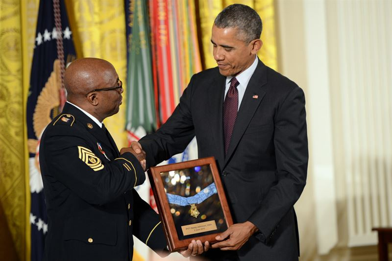 Army Command Sgt. Maj. Louis Wilson, New York National Guard senior enlisted advisor, accepts the Medal of Honor on behalf of Pvt. Henry Johnson, who served during World War I with the 369th Infantry Regiment, known as the Harlem Hellfighters, June 2, 2015, at the White House. (Credits: DOD photo by Lisa Ferdinando)