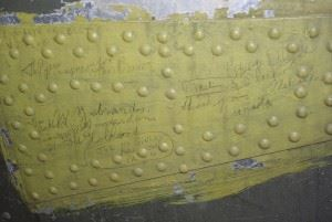 Many surfaces of the B-26 Marauder bear the penciled autographs of service members. Flak-Bait was a celebrity by the end of World War II; soldiers left their mark as proof they'd met a star. (Credits: Michelle Z. Donahue)