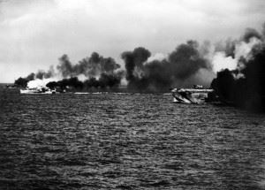 Gambier Bay and her escorts laying a smoke screen early in the battle.