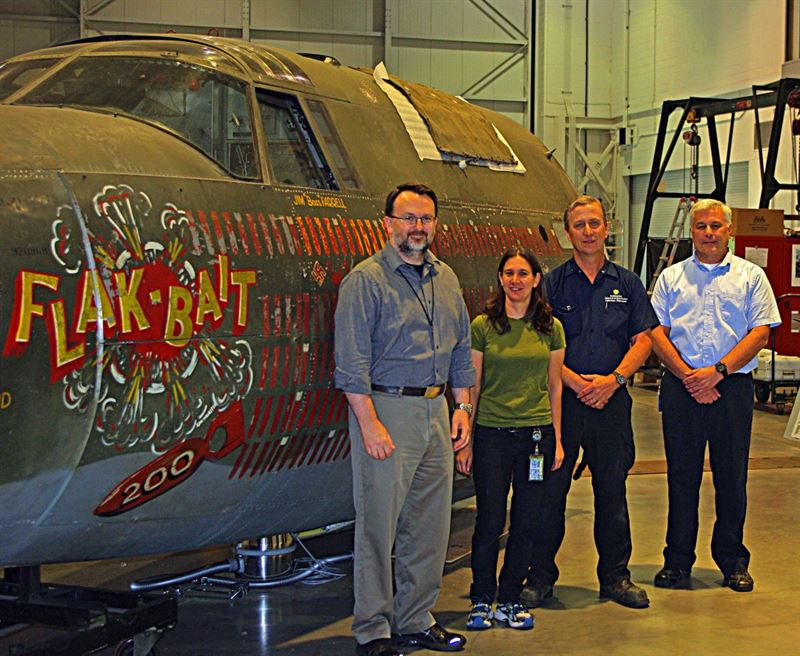 With Flak-Bait front fuselage, conservation team members from left, Jeremy Kinney, Lauren Horelick, Pat Robinson and Chris Moore. (Credits: Michelle Z. Donahue)
