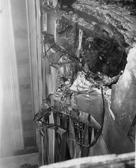 The plane embedded in the side of the building, 1945