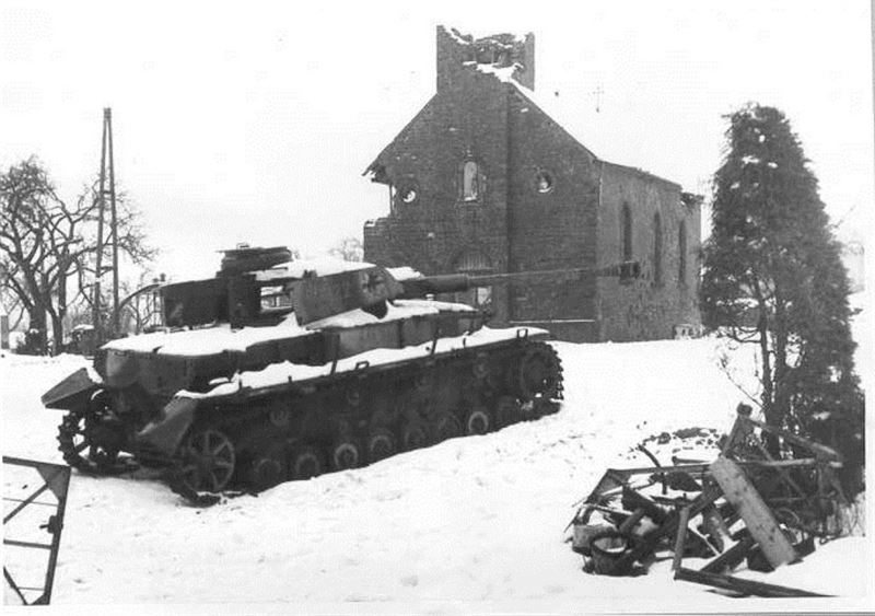 A knocked out Panzerkampfwagen IV in front of the Church of Foy.
