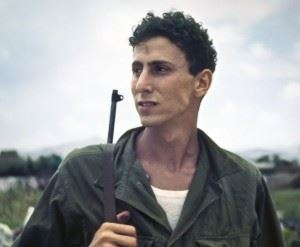 """Jerry Smith, on Okinawa during WWII. Jerry served in the Army's 718th Amphibious Tractor Battalion of XXIV Corps. He was a driver and armorer on an LVT-4 amphibian tractor, or """"amtrac."""" (Credits: Michael Smith)"""