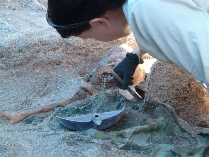 Lead archaeologist Kristen N. Baker of History Flight, Inc., carefully exposes the remains of Medal of Honor recipient, First Lt. Alexander Bonnyman Jr., in May. (Credits: Clay Bonnyman Evans/History Flight, Inc.)