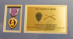 The Purple Heart Medal of Pvt. Joseph E. Bone. (Credits: Maj. Randall Stillinger)