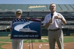 Secretary of the Navy (SECNAV) Ray Mabus announces the name of the Independence-class littoral combat ship LCS 24 as USS Oakland during a major league baseball game between the Oakland Athletics and Los Angeles Dodgers.