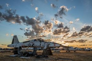 """A retired T-38 Talon sits in pieces inside the """"Boneyard"""" at Davis-Monthan Air Force Base, Ariz. Officially called the 309th Aerospace Maintenance and Regeneration Group, the """"Boneyard"""" is a 2,600-acre facility that stores more than 4,000 airframes from around the U.S. military. (Credits: U.S. Air Force photo/Andrew Breese)"""