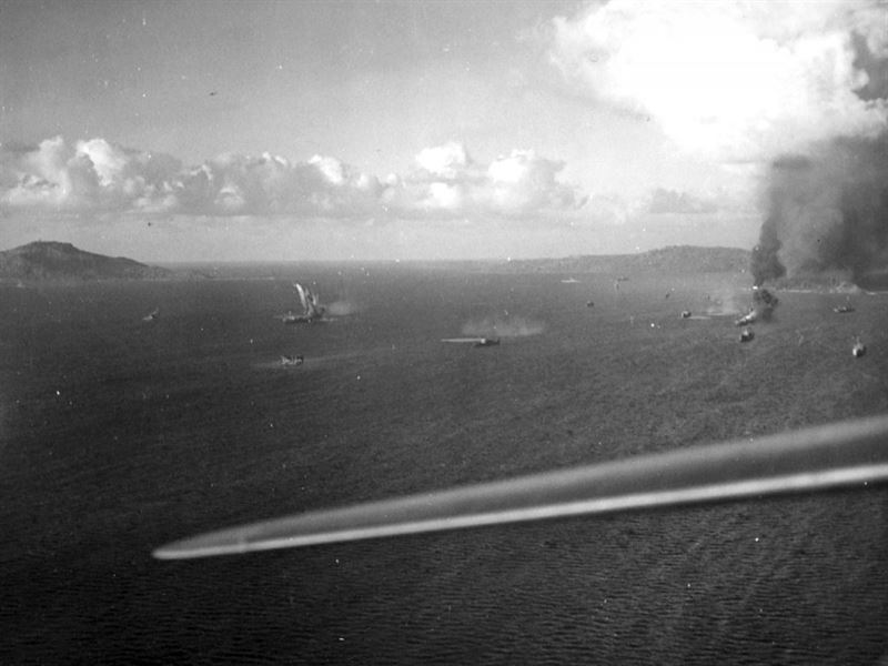 Japanese ships in Truk Lagoon under attack, 16 February 1944. Eten Island is at right. The photo was taken from a U.S. Navy Grumman TBF Avenger of Torpedo Squadron Six (VT-6) from USS Intrepid (CV-11) at about 0845 hrs. (Credits: U.S. Navy)