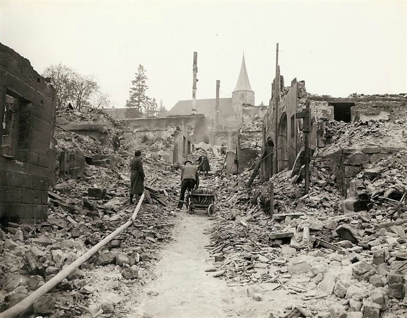 """German civilians in the middle of their town. Gen. Palmer remarked: """"Well liberated town."""""""