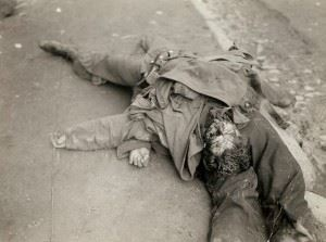 Horrors of World War 2: Bodies of German soldiers on top of each other lying in the street gutter, France.
