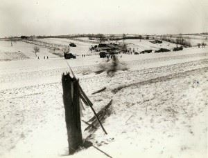 Path of a B-17 as it crash-landed into a snow covered field on the Seventh Army front. Pilot escaped with minor cuts when he rode the plane in after the crew bailed out. Note: Pole in foreground clipped by the plane as it came in.