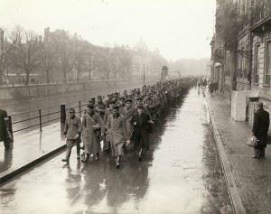 Prisoners of War from the German Military Police force and Gestapo agents of the city of Strasbourg are led to the 3rd Infantry Division.