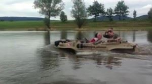 Schwimmwagens riding in a river