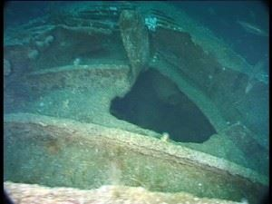 On the highest part of the wreck forward of the conning tower is the shell exit hole. (Credits: Innes McCartney)