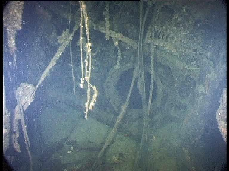 The bulkhead door into the forward torpedo room is open. It beckons, but prudence takes over and the unplanned penetration of this wreck stops here (Credits: Innes McCartney)
