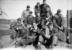 USAAF Airmen, probably from a B-24 Liberator Bomb Group, posing for the camera on the Airfield