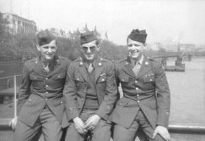 USAAF personnel enjoying a day in London, they are sitting on the Westminster Bridge, London, United Kingdom with the Thames behind them.