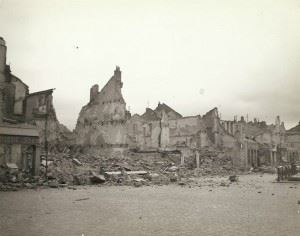 """Wrecked and burned buildings in France. The buildings were mined and burned by the Germans. """"Remains of a friendly little town, that was 'scorched'"""", Gen. Palmer wrote on the backside."""