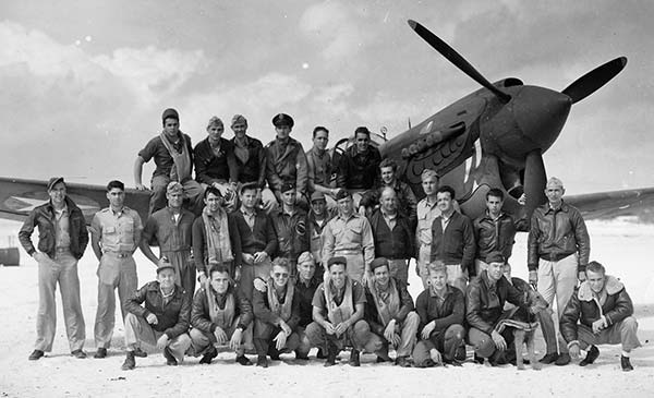 United States Army Air Forces (USAAF) 78th Fighter Squadron, stationed at Midway from January 23 until April 21, 1943 to protect the island, its garrison and fortifications and the submarine and communications base from enemy attacks. Lt. Ray Obenshain is the third from the right in the second row from the bottom. (Credits: Mark Stevens, 7th Fighter Command Association)