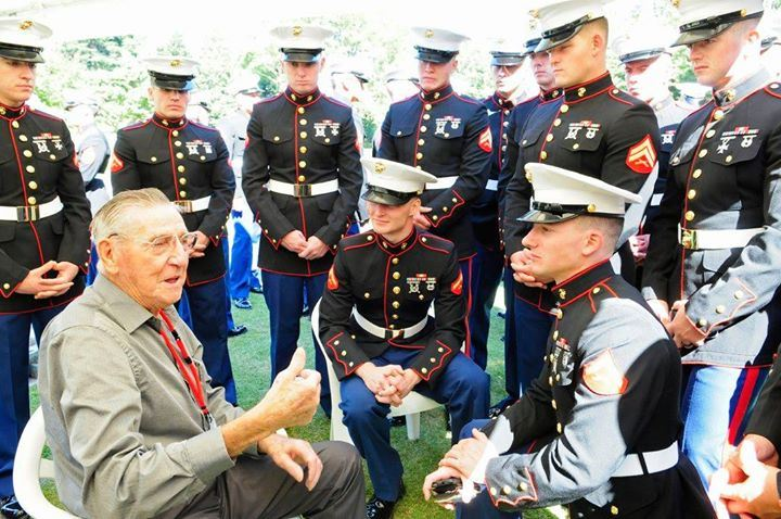 Former prisoner-of-war tells stories of his experiences in a Japanese camp to Fleet Anti-Terrorism Security Team Pacific (FASTPAC) Marines at the Commonwealth War Cemetery in the sixth annual service of reconciliation, as part of the Japanese/ POW(s) Friendship Program. The event honored nine POWs from the U.S. Army and Marine Corps. (U.S. Navy photo by Mass Communication Specialist 2nd Class Indra Bosko)