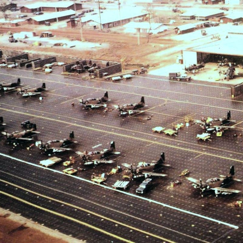 U.S. Air Force 56th Special Operations Wing Douglas A-1E and A-1H/J Skyraiders at Nakhon Phanom Royal Thai Air Force Base prepare for missions over Laos, ca. 1968-69.
