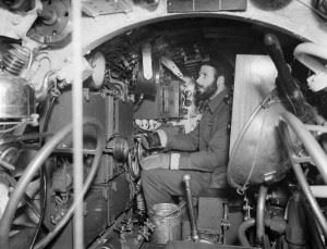 Sub Lieutenant K C J Robinson, RNVR, of Crosby, Liverpool, a Commanding Officer in an X-craft at the Hydroplane controls whilst sailing in Rothesay Bay. (Credits: Imperial War Museum)