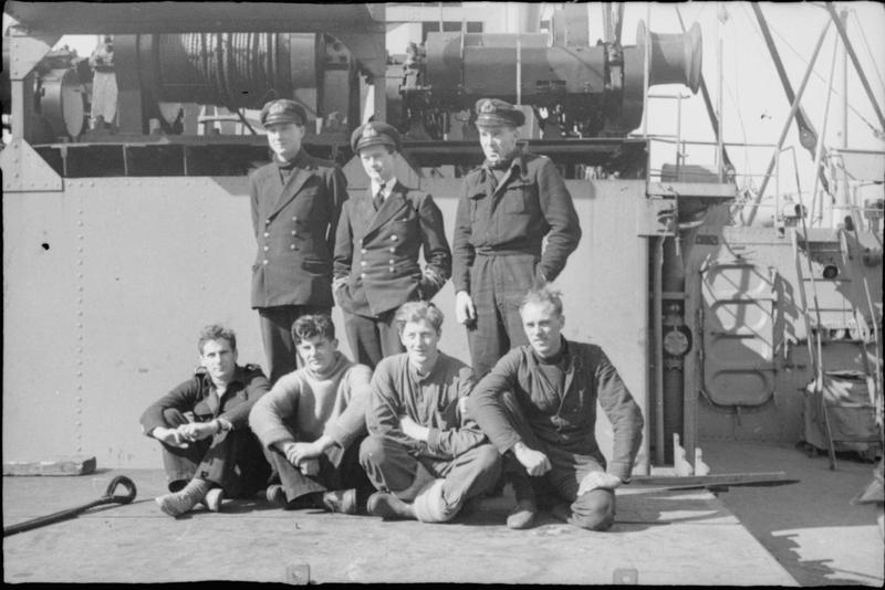 Lieutenant Donald Cameron RNR and the crew of X 6, one of the midget submarines that made a successful attack on the TIRPITZ at Alten Fjord, on the deck of a ship. (Credits: Imperial War Museum)