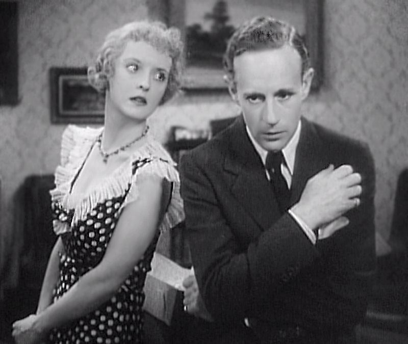 Howard next to Bette Davis in Of Human Bondage (1934)